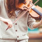 woman-in-gray-cardigan-playing-a-violin-during-daytime-111287.jpg