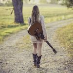 woman-in-white-long-sleeve-dress-carrying-a-guitar-164767.jpg